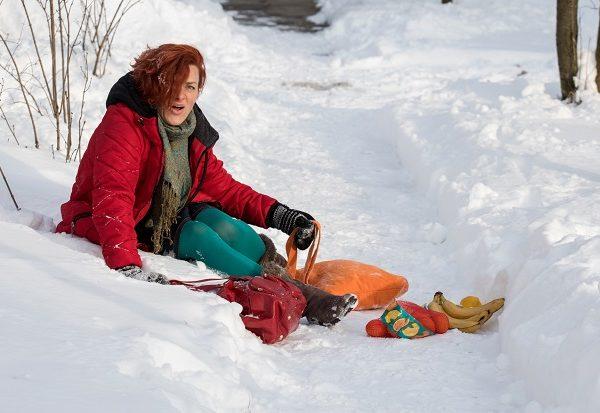 woman fell on snowy sidewalk